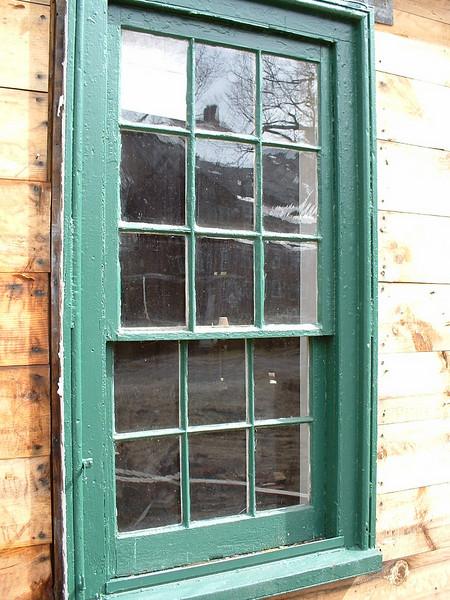 Late 1700's nine-over-six window BEFORE restoration.