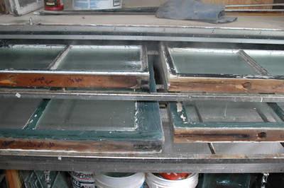 Original wood windows being steamed in preparation for chemical-free paint removal.