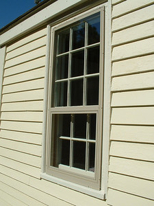 This is an Allied Storm Window model HOL B with an interior removable panel.  The top sash of the home's window is in-operable, while the bottom sash is operable.  The storm window is custom made the same way.  The top panel is a glass in-operable panel, while the bottom panel can be removed to the interior, and replaced with a screen.  This is one of Allied Storm Windows standard colors beige, the other standard colors are white, black, and bronze.  Notice how little the storm window sticks out from the exterior casing, it just blends right in.
