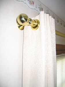 Grommet drapery on brass rod