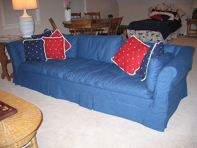 Slipcover on sofa with coordinating pillows
