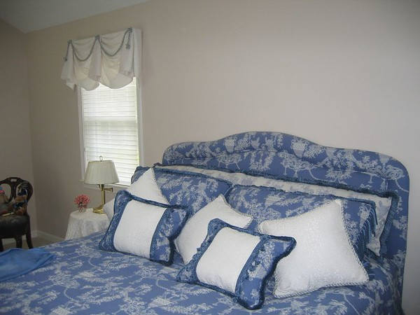 Upholstered headboard with matching pillows and spread