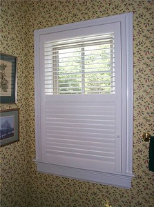 Plantation shutters, upper louvers open for light & lower louvers closed for privacy