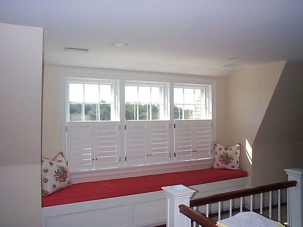 Plantation shutters cafe' style in hall window seat