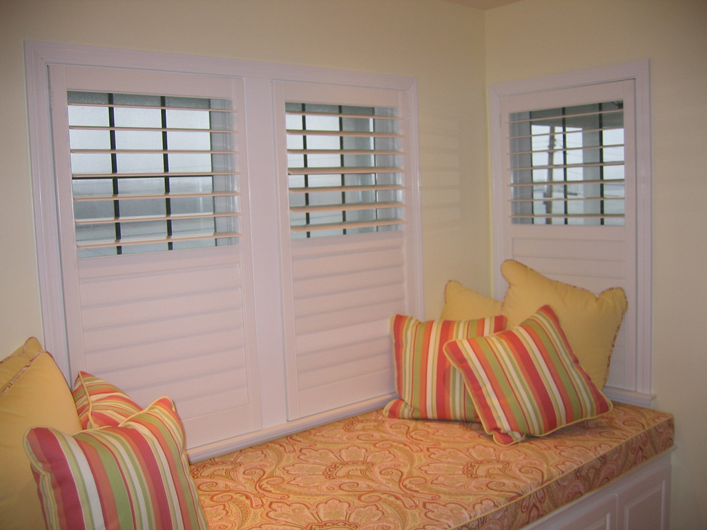 Plantation Shutters with divider rail allowing individual control of top & bottom sets of louvers