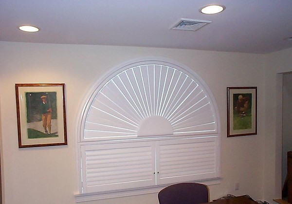 Plantation shutters in arched window, closed