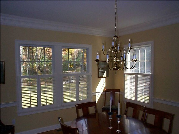 Plantation shutters cafe' style, open in dining room