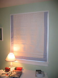 Roman Shades with contrast banding, lowered