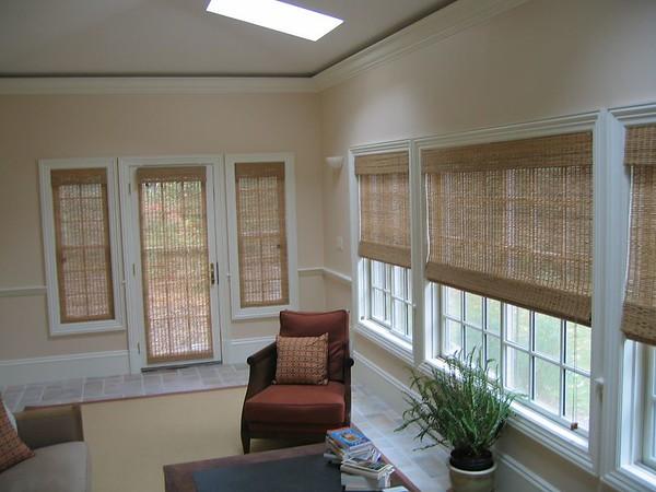 Woven Wood Roman Shades on sun porch