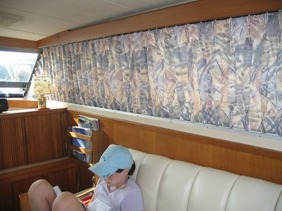 Boat Draperies slide on tracks to uncover windows