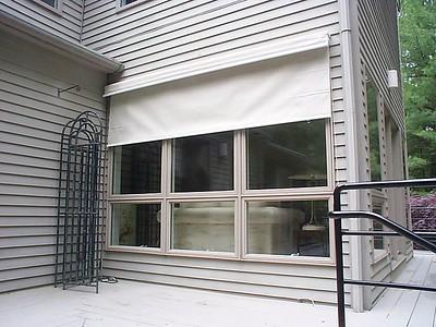 Exterior Solar Screen shade, partly open for sun glare protection