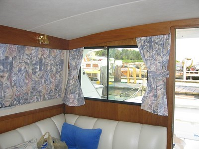 Sliding boat curtains aboard Power Boat