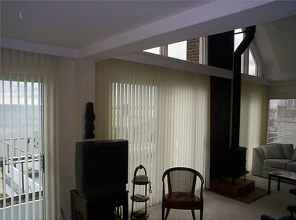 Vertical Blinds on left & center, Micro blind on right for sun protection & view