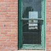 Red Brick and mesh window, Greeley, Colorado