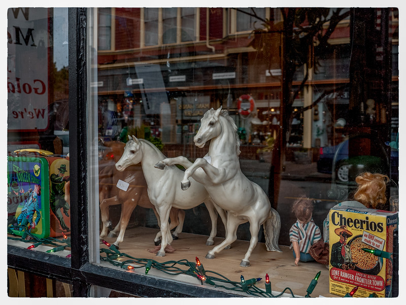 I now wish I had bought these two white horses!
