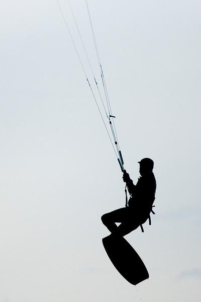 Kite-boarder, aerial silhouette.