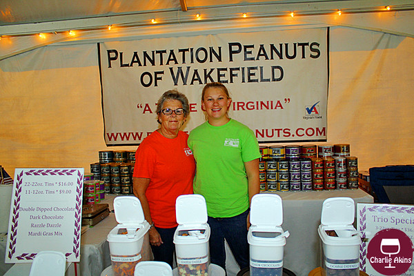 These ladies sell a variety of peanuts.