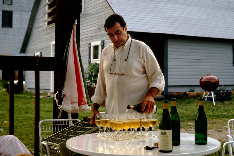 "The owner of West Park Winery, pouring samples of his - may I say ""our""? - Chardonnay, c.1987"