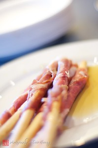 Honey-glazed prosciutto-wrapped breadsticks