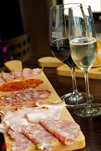 Salumi platter and wine at Cantinetta Piero restaurant of Hotel Luca, Yountville, California