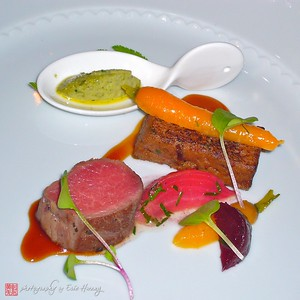 Spring Lamb, Two Ways  Herb-Roasted Loin and Lamb Confit Pavé with a Housemade Worchestershire Glaze, Fava Bean Brandade (in the spoon) and Roasted Beets and Baby Carrots.