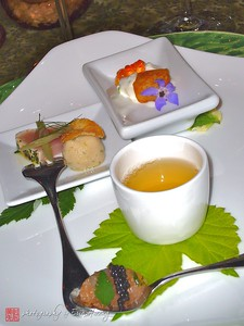 "On the Incoming Tide  Clockwise starting with the cup, Lemon Thyme-Scented Puget Sound Prawn Consommé, Puget Sound Prawn Tartare with Montana Paddlefish Caviar (in the spoon), St. Jude Albacore with Pickled Herbfarm Fillet Beans and Fennel Pollen Chip and finally Potato Fondant, ""Onion Dip,"" and Smoked Steelhead Caviar."