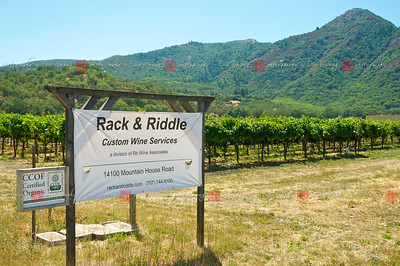 A modest sign marks the entrance to Rack & Riddle