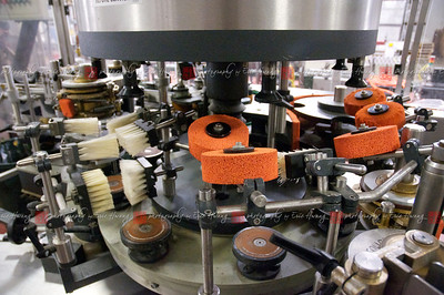 A labeling machine that applies a special adhesive to label the cold, wet bottles