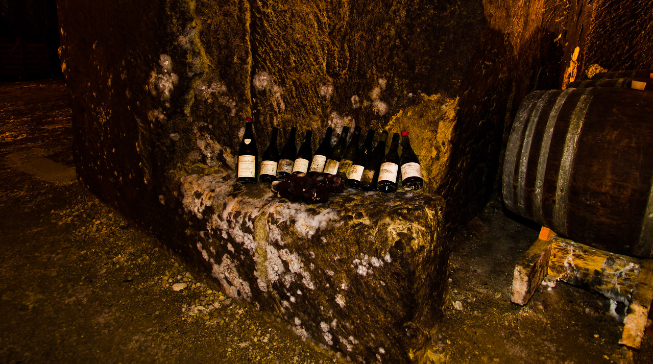 Perhaps 20 or more meters inside the caves of François Bobinet's winery in Saumur Champigny, in the heart of the Loire Valley, lies the remains of a few choice bottles from various producers in the region. Winemaking is hard work and requires inspiration from time to time. Seriously, it was very dark in here - just imagine 2 light bulbs for your whole house, it was darker.