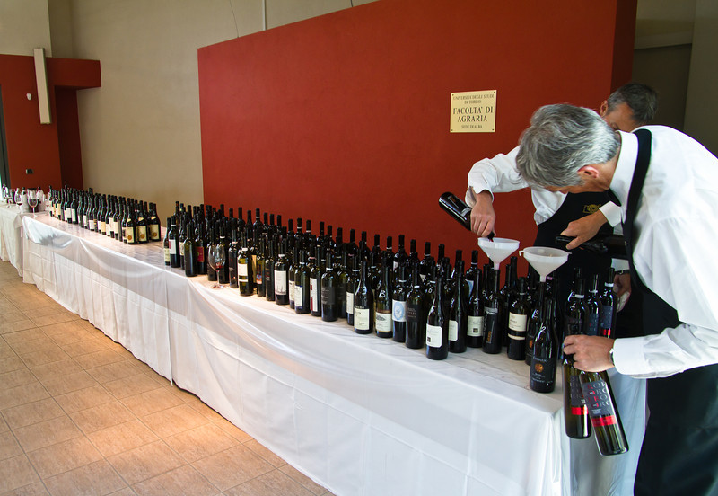 Each year, in early May, wine-buyers and journalists attend Nebbiolo Prima, a week-long exploration and evaluation of the year's newly released wines of Barolo and Barbaresco. This picture is typical of the approximately 65 different releases we taste each day, for 5 continuous days.