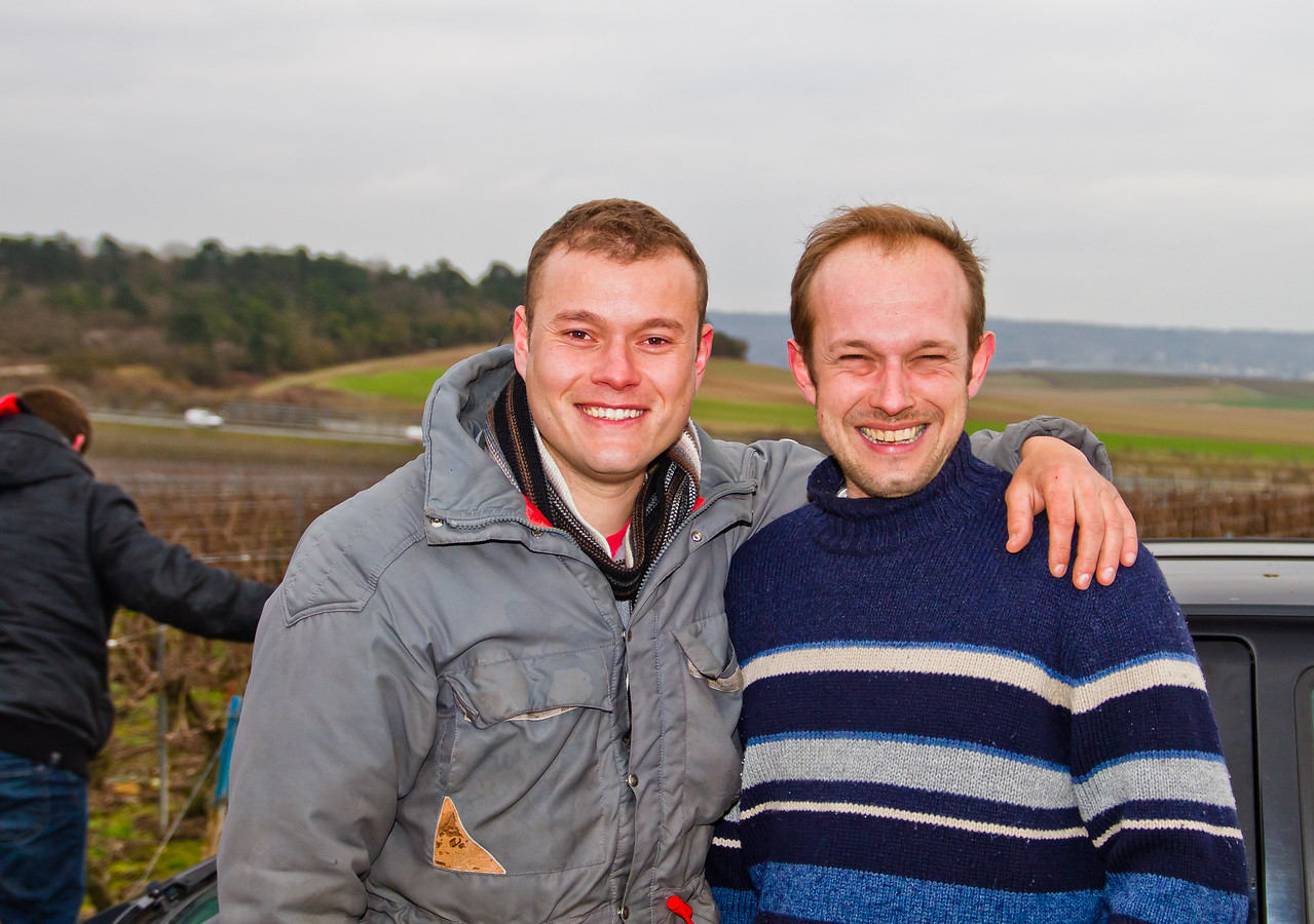 As we end a cold, windy and rainy day of pruning in 1er Cru vineyards in Champagne, François Guerin, viticulturist, oenologist and teacher (R) takes time for a picture with one of his students. The spirit these people have is infectious, in a very, very good way.