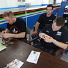 James Grinstead and Mikael Silen conduct G27 Lite tech inspection while Jay Herrod looks on.