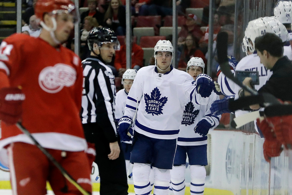 . Toronto Maple Leafs center Auston Matthews greets teammates after scoring during the second period of the team\'s NHL hockey game against the Detroit Red Wings, Saturday, April 1, 2017, in Detroit. (AP Photo/Carlos Osorio)