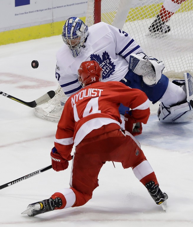 . Toronto Maple Leafs goalie Frederik Andersen deflects a shot by Detroit Red Wings right wing Gustav Nyquist (14) during the first period of an NHL hockey game, Saturday, April 1, 2017, in Detroit. (AP Photo/Carlos Osorio)