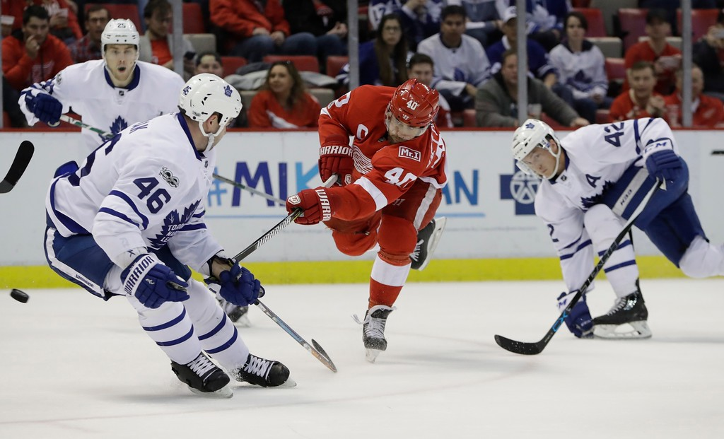 . Detroit Red Wings left wing Henrik Zetterberg (40) shoots while defended by Toronto Maple Leafs defenseman Roman Polak (46) and center Tyler Bozak (42) during the second period of an NHL hockey game, Saturday, April 1, 2017, in Detroit. (AP Photo/Carlos Osorio)
