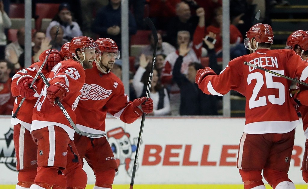 . Detroit Red Wings defenseman Niklas Kronwall (55) is congratulated by teammates after scoring during the third period of an NHL hockey game against the Toronto Maple Leafs, Saturday, April 1, 2017, in Detroit. (AP Photo/Carlos Osorio)