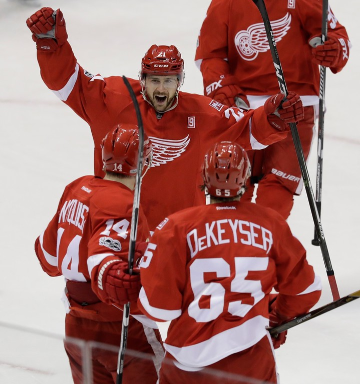 . Detroit Red Wings left wing Tomas Tatar, center, approaches right wing Gustav Nyquist (14) and defenseman Danny DeKeyser (65) to congratulate Nyquist on his goal during the first period of an NHL hockey game against the Toronto Maple Leafs, Saturday, April 1, 2017, in Detroit. (AP Photo/Carlos Osorio)