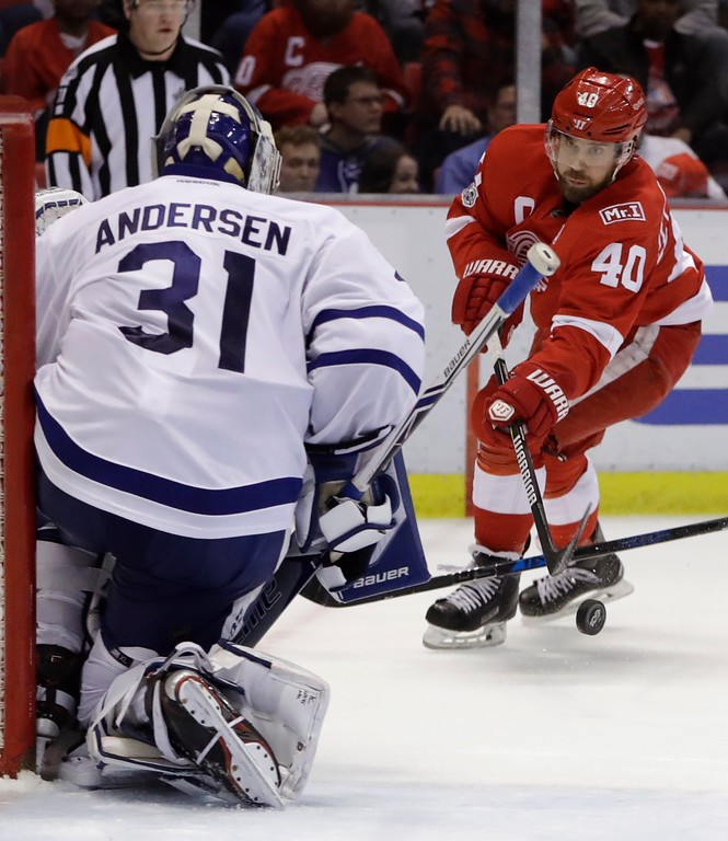 . Detroit Red Wings left wing Henrik Zetterberg (40) shoots toward Toronto Maple Leafs goalie Frederik Andersen (31) during the second period of an NHL hockey game, Saturday, April 1, 2017, in Detroit. (AP Photo/Carlos Osorio)