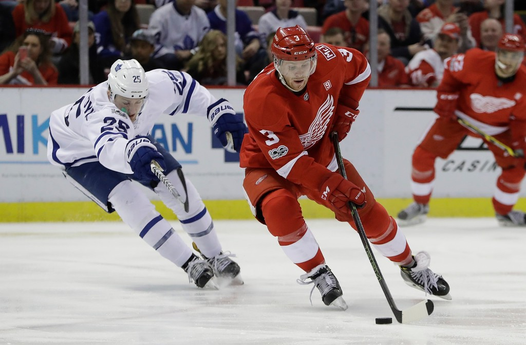 . Detroit Red Wings defenseman Nick Jensen (3) controls the puck next to Toronto Maple Leafs left wing James van Riemsdyk (25) during the second period of an NHL hockey game, Saturday, April 1, 2017, in Detroit. (AP Photo/Carlos Osorio)