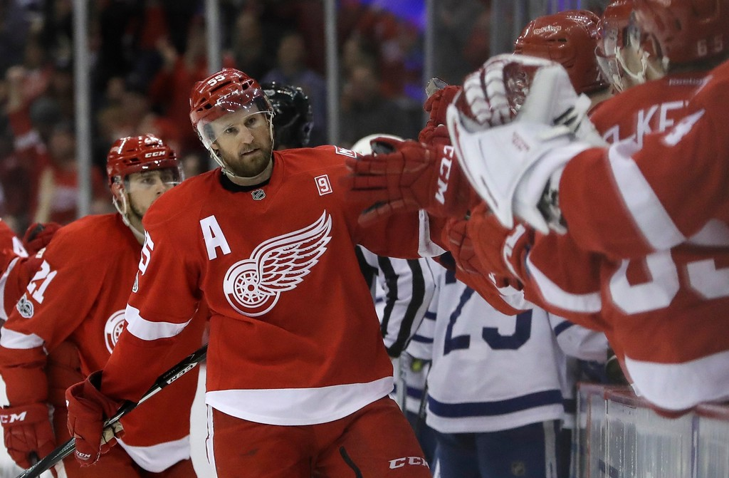 . Detroit Red Wings defenseman Niklas Kronwall is congratulated after scoring during the third period of the team\'s NHL hockey game against the Toronto Maple Leafs, Saturday, April 1, 2017, in Detroit. (AP Photo/Carlos Osorio)