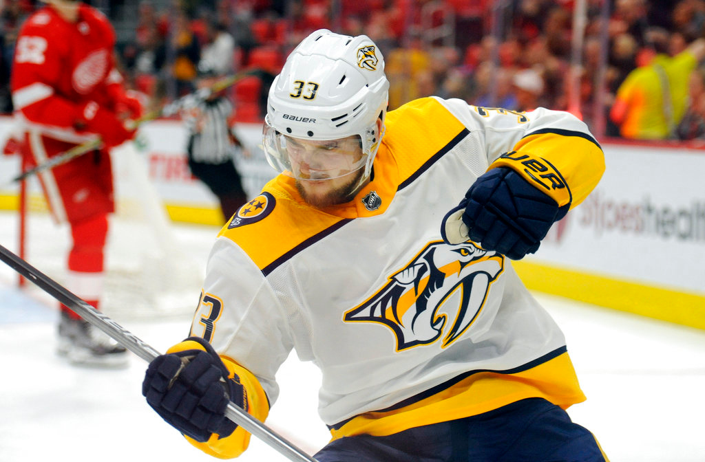 . Nashville Predators left wing Viktor Arvidsson (33) reacts after scoring against the Detroit Red Wings in the third period of an NHL hockey game, Tuesday, Feb. 20, 2018, in Detroit. (AP Photo/Jose Juarez)