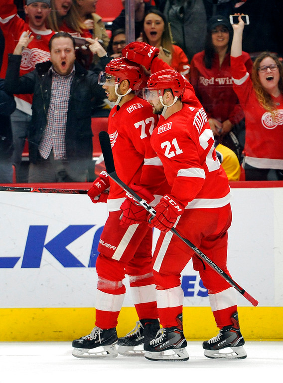. Detroit Red Wings left wing Andreas Athanasiou (72) is congratulated by left wing Tomas Tatar (21) of Slovakia after scoring a goal against the Nashville Predators in the second period of an NHL hockey game, Tuesday, Feb. 20, 2018, in Detroit. (AP Photo/Jose Juarez)