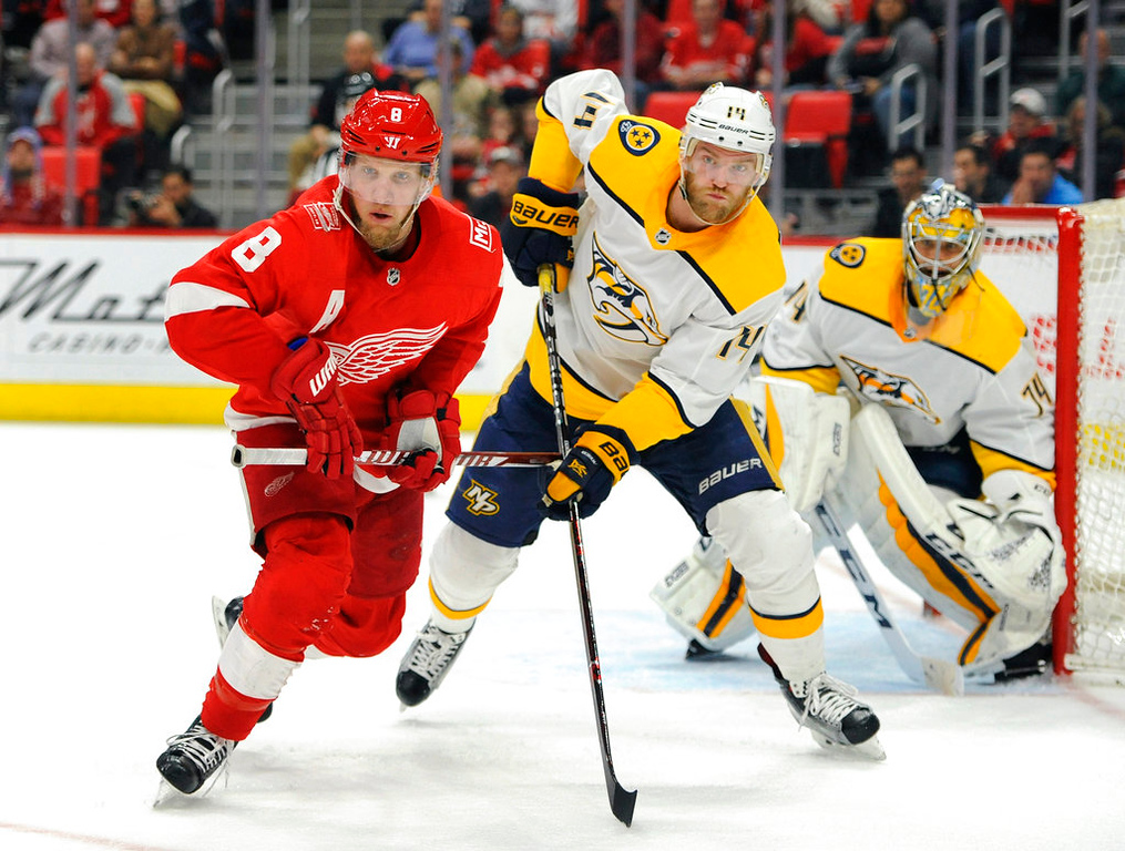 . Detroit Red Wings left wing Justin Abdelkader (8) is guarded by Nashville Predators defenseman Mattias Ekholm (14) in the second period of an NHL hockey game, Tuesday, Feb. 20, 2018, in Detroit. (AP Photo/Jose Juarez)