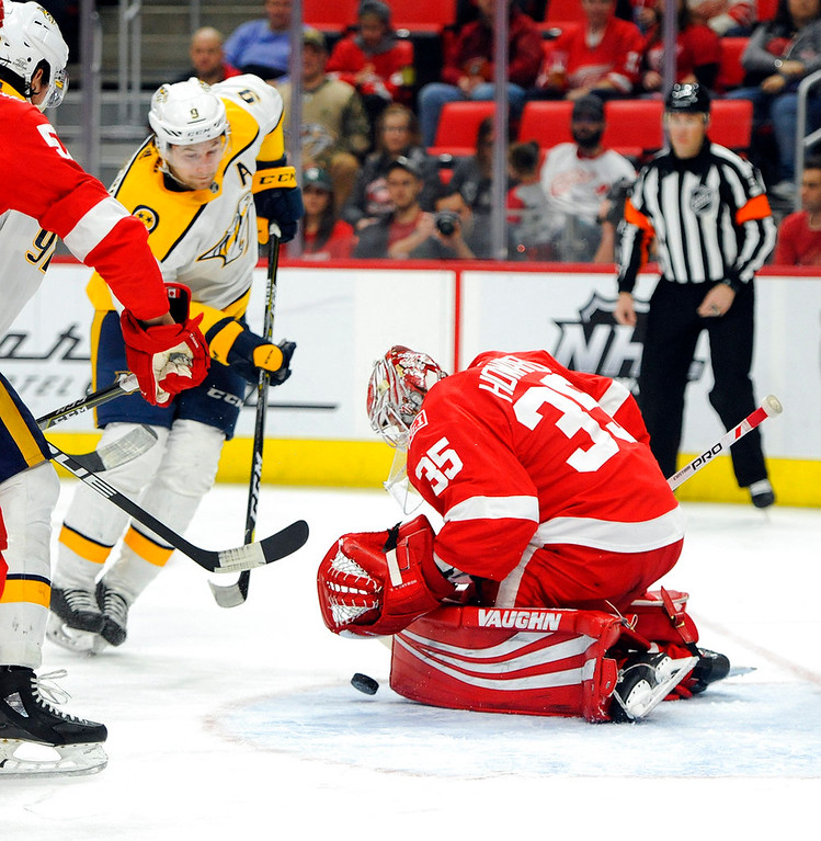 . Detroit Red Wings goaltender Jimmy Howard (35) stops the shot of Nashville Predators left wing Filip Forsberg (9) in the first period of an NHL hockey game, Tuesday, Feb. 20, 2018, in Detroit. (AP Photo/Jose Juarez)