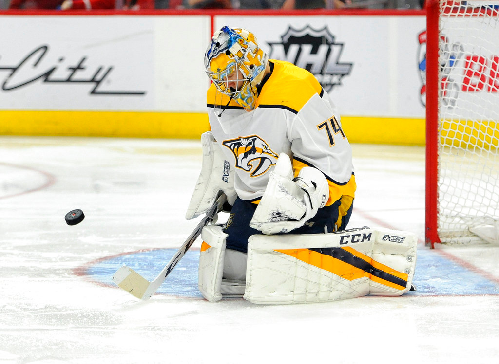 . Nashville Predators goaltender Juuse Saros (74) stops a shot against the Detroit Red Wings in the second period of an NHL hockey game, Tuesday, Feb. 20, 2018, in Detroit. (AP Photo/Jose Juarez)