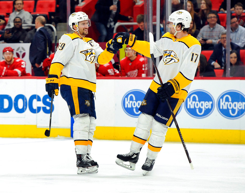. Nashville Predators defenseman Roman Josi (59) congratulates left wing Scott Hartnell (17) on his goal against the Detroit Red Wings in the first period of an NHL hockey game, Tuesday, Feb. 20, 2018, in Detroit. (AP Photo/Jose Juarez)