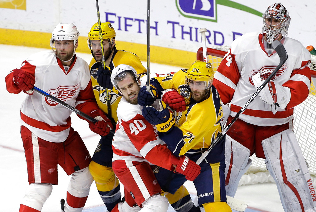 . Detroit Red Wings left wing Henrik Zetterberg (40), of Sweden, and Nashville Predators left wing Eric Nystrom (24) battle for position in front of the net as Red Wings\' Jakub Kindl (4), of the Czech Republic; Predators\' Paul Gaustad (28) and Red Wings goalie Petr Mrazek (34), of the Czech Republic, watch the play during the third period of an NHL hockey game Saturday, Dec. 26, 2015, in Nashville, Tenn. The Red Wings won 3-2. (AP Photo/Mark Humphrey)