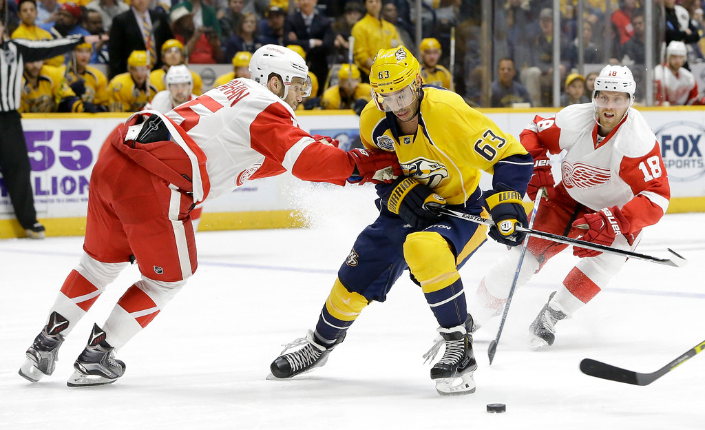 . Nashville Predators center Mike Ribeiro (63) is defended by Detroit Red Wings\' Riley Sheahan (15) and Joakim Andersson (18), of Sweden, during the second period of an NHL hockey game Saturday, Dec. 26, 2015, in Nashville, Tenn. (AP Photo/Mark Humphrey)