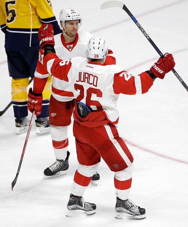 . Detroit Red Wings right wing Tomas Jurco (26), of Slovakia, celebrates with center Luke Glendening (41) after Glendening scored a goal against the Nashville Predators during the third period of an NHL hockey game Saturday, Dec. 26, 2015, in Nashville, Tenn. The Red Wings won 3-2. (AP Photo/Mark Humphrey)