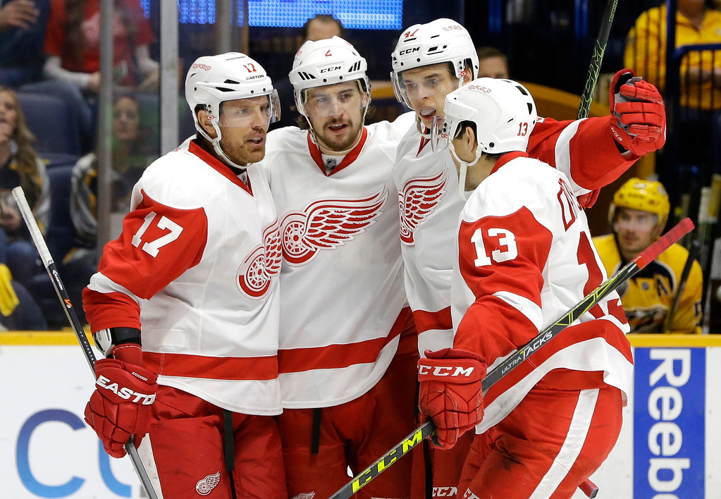 . Detroit Red Wings defenseman Brendan Smith (2), is congratulated by Brad Richards (17); Alexei Marchenko (47), of Russia; and Pavel Datsyuk (13), of Russia, after Smith scored a goal against the Nashville Predators during the first period of an NHL hockey game Saturday, Dec. 26, 2015, in Nashville, Tenn. (AP Photo/Mark Humphrey)